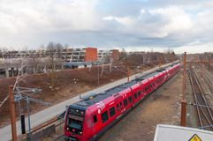 Danish local train arrives to Hoje Taastrup train station in Denmark. Hoje Taastrup Denmark - February 27. 2018: Danish local train arrives to Hoje Taastrup Stock Images