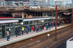 People waiting for the traIn at Hoje Taastrup train station. Hoje Taastrup Denmark - February 27. 2018: People waiting for the traIn at Hoje Taastrup train Stock Photo