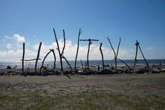 Hokitikanz teken op strand Stock Foto's