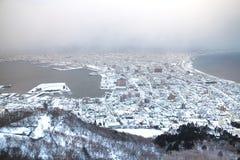 HOKKAIDO, JAPÃO 26 de janeiro 2016: Por do sol na opinião da cidade de Hakodate de Foto de Stock