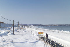 HOKKAIDO, JAPAN-JAN. 31, 2016: A beach is covered by snow in Hok. A beach is covered by snow in Hokkaido. Hokkaido is the most northern main island in Japan Stock Images