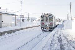 HOKKAIDO, JAPAN-JAN. 31, 2016: A train is approaching the train. A train is approaching the train station in Hokkaido. Hokkaido is the most northern main island Stock Photography