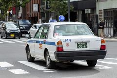Hokkaido japan - october8,2018 : old toyota taxi driving on sapp stock photos