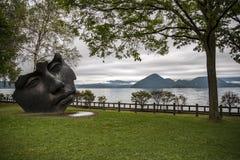 Face sculpture at Toya Lake, Hokkaido, Japan stock photo