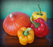 Hokkaido pumpkin and red and yellow peppers Stock Images