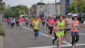 Hokkaido Sapporro Japón vigésimo de los corredores de maratón de agosto de 2017 de todas partes del mundo que recolecta en el eve Foto de archivo libre de regalías