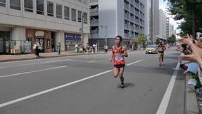 Hokkaido Sapporro Japón vigésimo de los corredores de maratón de agosto de 2017 de todas partes del mundo que recolecta en el eve Imagen de archivo