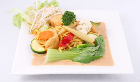 Hokkien noodles with red curry sauce and fresh vegetables  Royalty Free Stock Photography