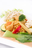 Hokkien noodles with red curry sauce and fresh vegetables  Stock Photography