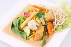 Hokkien noodles with red curry sauce and fresh vegetables  Royalty Free Stock Photos