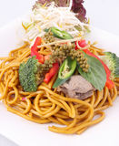 Hokkien noodles stir frief with Thai herb. Royalty Free Stock Images