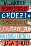 Hola de madera firma adentro diversas idiomas Fotos de archivo libres de regalías