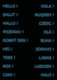 Hola en muchas idiomas, en color azul Fotografía de archivo