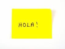 Hola! geschrieben auf eine klebrige Anmerkung Stockfotografie