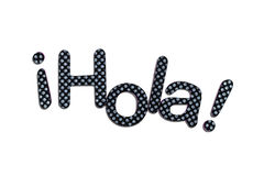 Hola lettering. A spanish hola banner made of rubber letters Royalty Free Stock Photos