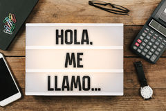 Hola, me llamo…, Spanish text for Hello, My Name is. Hola, me llamo, Spanish text for Hello, My Name is, vintage style light box on office desktop, high stock images