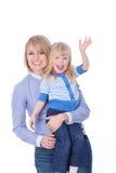 Hola que agita de la mama sonriente feliz y del niño Foto de archivo libre de regalías