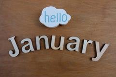 Hola texto de enero con las letras de madera foto de archivo