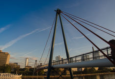 The Holbeinsteg bridge with the skyline of Frankfurt, Germany Royalty Free Stock Photography