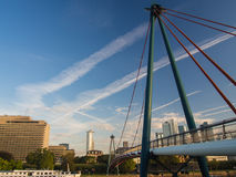 The Holbeinsteg bridge with the skyline of Frankfurt, Germany Royalty Free Stock Photo