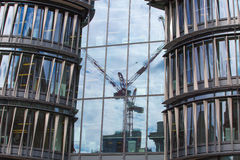 Holborn office building with crane reflection Stock Photo