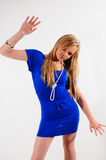 Hold it. Young female fashion model wearing a dress and with her hands spread apart Royalty Free Stock Photos