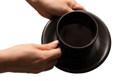 Hold the black coffee in brown cup on white background. The file Stock Image