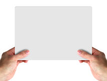 Hold blank card. Business man holding a blank sheet of card stock image