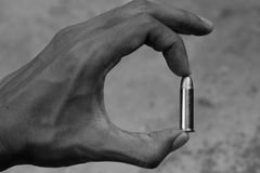 Hold a bullet. Black and white royalty free stock photo
