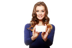 Hold card. Beautiful woman holds out a business or credit card Isolated on white background Stock Photo