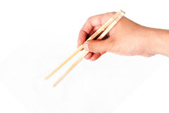 Hold chopsticks Stock Image