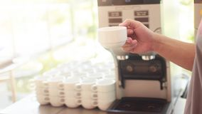 Hold the coffee cup in front of the coffee machine. royalty free stock images