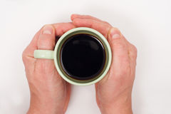 Hold a cup of coffee Stock Photography