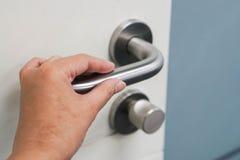 Hold doorknob to open the office door Stock Photo