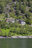 Hold farm on the fjord. A old and isolated farm on the Nearofjord, one of the worlds most beautiful and dramatic fjords. Norway Royalty Free Stock Photos