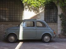An hold Fiat 500. light blue color.  Stock Photo