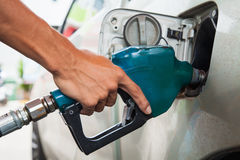 Hold Fuel nozzle. To add fuel in car at gas station royalty free stock photos