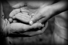 We hold the future in our hands. Hands of wedding couple, holding holds, holding rings, ready to make a vow Royalty Free Stock Photo
