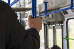 Hold the handrails. Stock Image