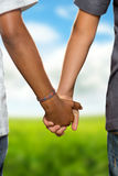 Hold hands Stock Images