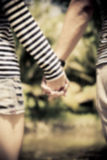 Hold the hands of couple in blur style Royalty Free Stock Photos