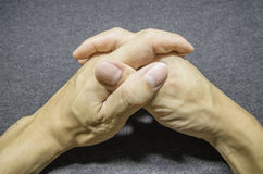 Hold hands. Of fabric bacground Royalty Free Stock Photo