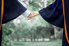 Hold hands of teen student. In garden celebration in education Stock Photography