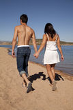 Hold hands walk beach Stock Image