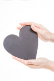 Hold heart in hands Stock Photos