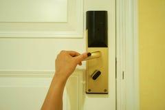 Hold the hotel luxury doorknob to enter Stock Image