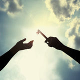 Hold key in sky Royalty Free Stock Image