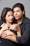 Hold me. Young couple in love cuddling Royalty Free Stock Image