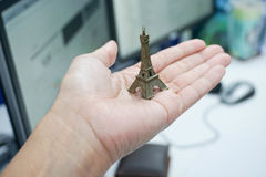 Hold model Eiffel Tower. In hand Royalty Free Stock Photos