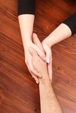 Hold my hand. Woman's hands holding man's hand royalty free stock photos